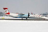Austrian Airlines De Havilland Canada DHC-8-402Q Dash 8 OE-LGB aircraft, named ''Tirol'', skating at Austria Salzburg W.A.Mozart International Airport. 23/02/2013.