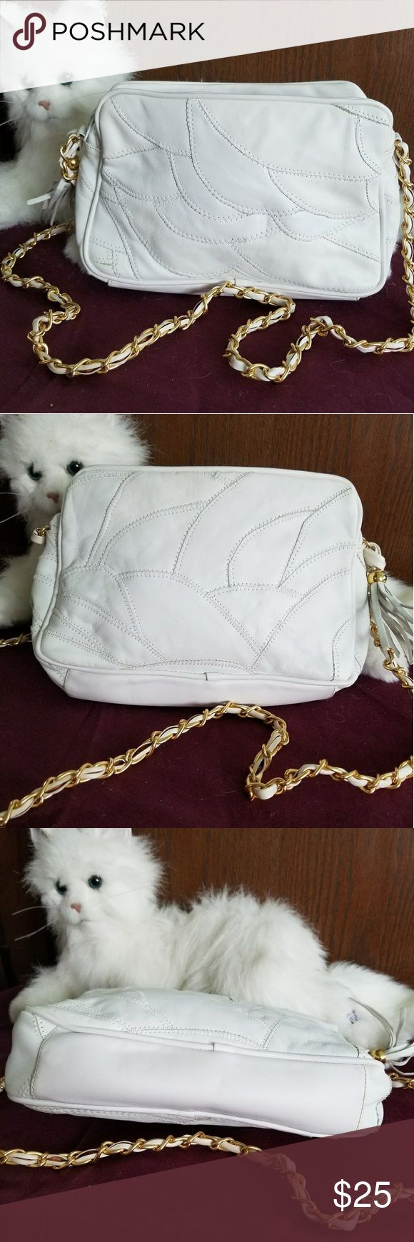 3 section white shoulder bag White bag with gold shoulder chain.has 3 sections. 1 section has no pockets and 1 section has a zippered pocket. Center pocket has a zippered pocket also and zips closed.preowned excellent condition none Bags Shoulder Bags