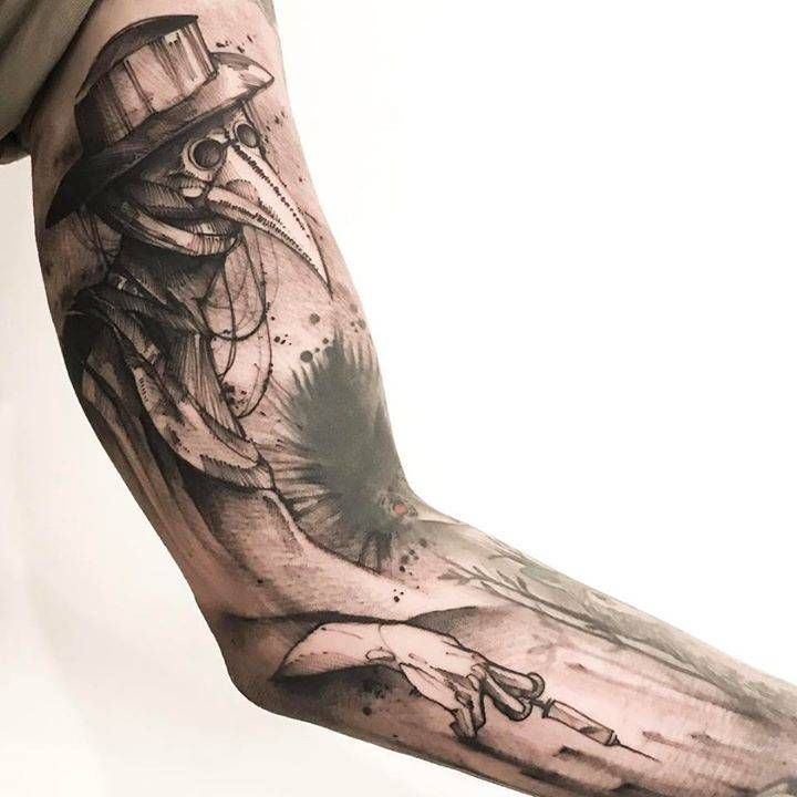 Sketchy plague doctor tattoo on the left arm.