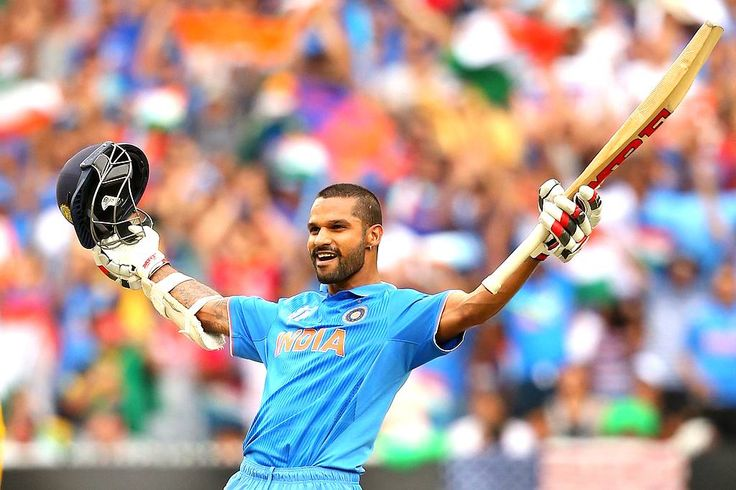 Shikhar Dhawan strikes his trademark pose after completing his century.