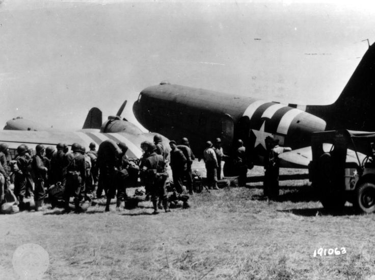 These non airborne troops await boarding this C-53. The C-53 was