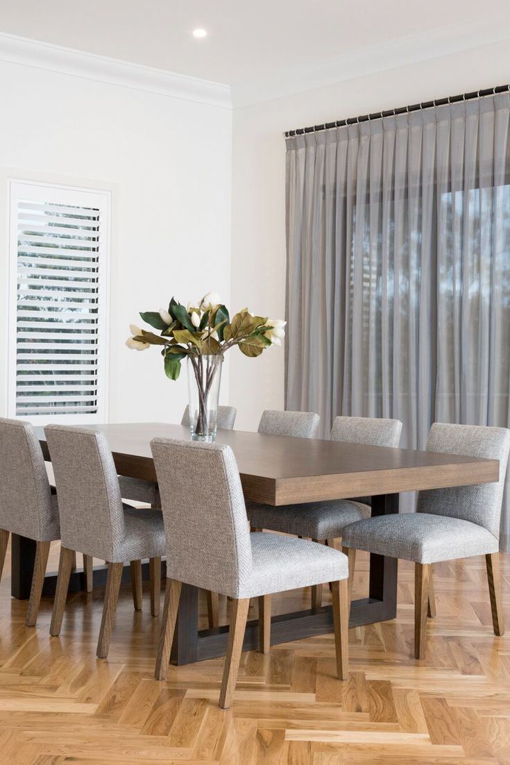 Emme Designs custom dining table and custom upholstered dining chairs.