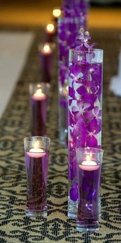 Food coloring and floating candles and orchids in vases can make a great centerpiece