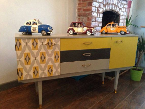 Saffron retro sideboard. Hand painted in mustard yellow, charcoal and dove grey, decoupaged with funky paper.