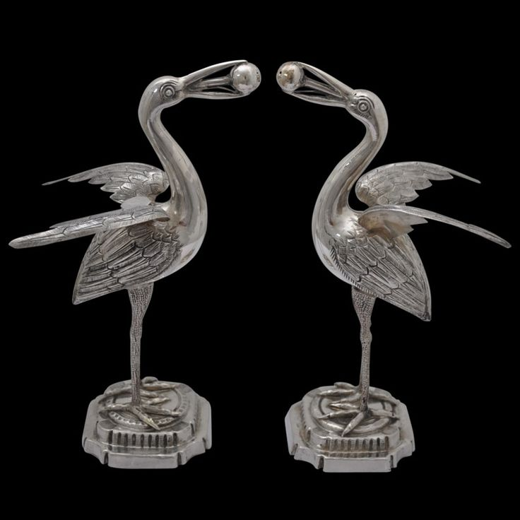 Pair of Heron-Shaped Silver Rosewater Sprinklers. India, circa 1900. This whimsical pair of rosewater sprinklers are fashioned from solid silver and are shaped as herons. Each is naturalistically modelled, and stands with wings out-stretched. The bodies and wings are chased with feather motifs. This and more important Asian art for sale on the CuratorsEye.com.