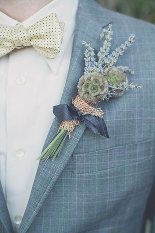 Not as much a fan of the actual flower arrangement, but love the color of his suit