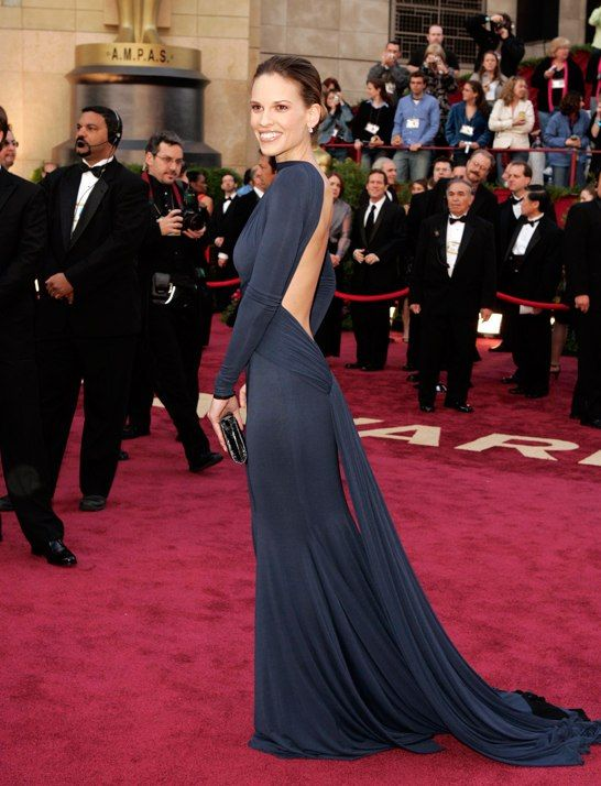 One of the best Oscars Dresses ever - In 2005 Hilary Swank wore a Guy Laroche navy knit dress with a jaw-dropping deep plunging backless design