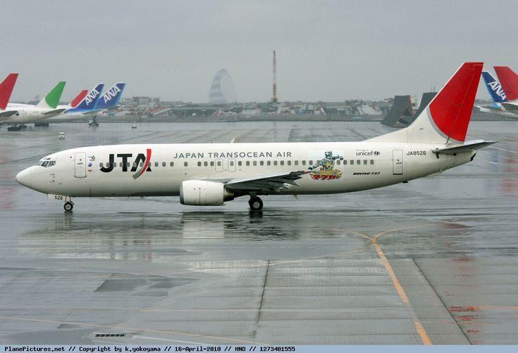 Japan TransOcean Air (JP) Boeing 737-4Q3 JA8526 aircraft, with the sticker ''Ryujin Mabuyar'' on the airframe, skating at Japan Tokyo Haneda International Airport. 16/04/2010.