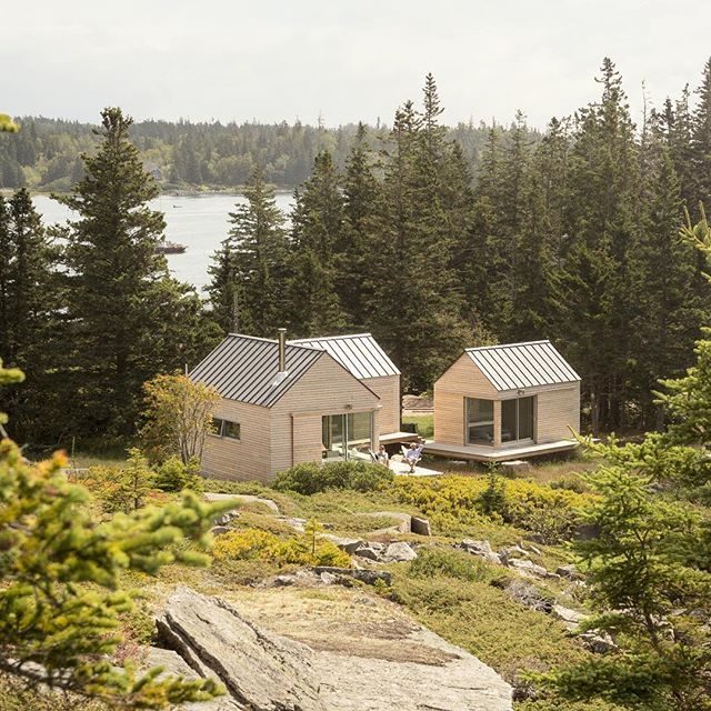 US firm Go Logic completed this summer house on the rocky coastline of Maine, made up of three wooden cabins each linked by terraced desks. We're rounding up the best American houses of 2016 and you can see even more examples on dezeen.com/architecture #architecture #house #USA