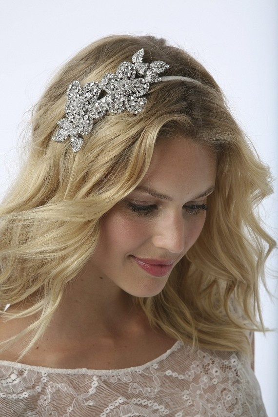 I LOVE this headband as a wedding accessory. Now to find it for less than 200+ freakin dollars! Yikes!