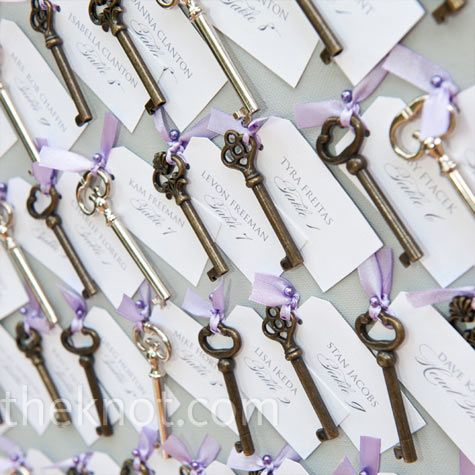 Skeleton key escort cards with name tags tied on using lavender ribbon.