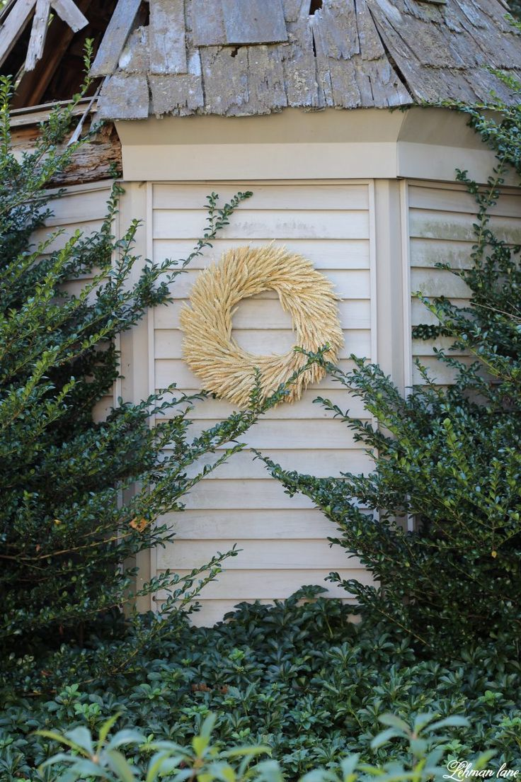 Stop by to see our fall patio and see even more beautiful outdoor spaces from my friends! #fall #falldecor #falloutdoors #fallpatio http://lehmanlane.net - garden shed and wheat wreath