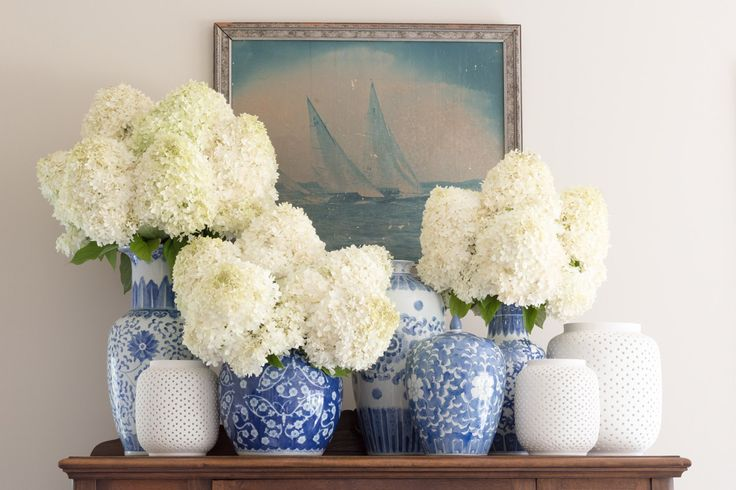 Living Room: Beach Style, Transitional Style, Blue and White Jars, Hydrangea, Sailboat Photograph, Pottery Collection Taupe Walls