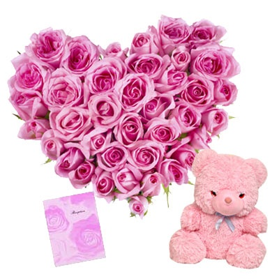 40 Pink roses heart shape arrangement with one cute 6 inch teddy bear and a free greeting card.