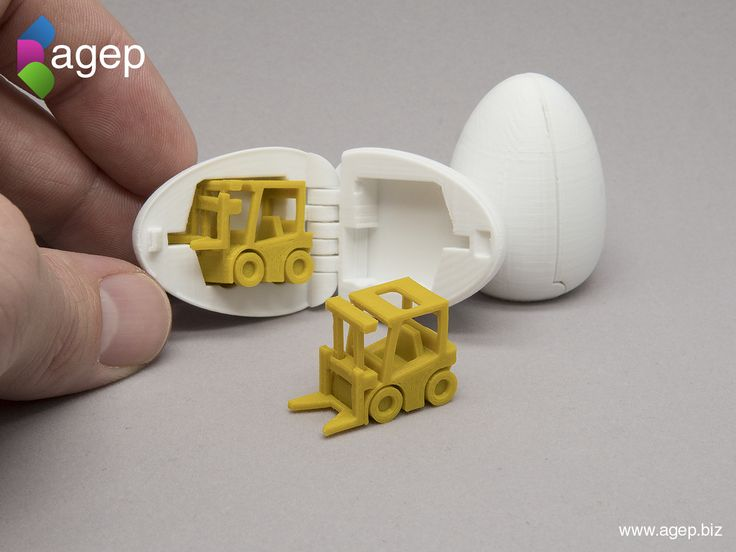 3D Printable Surprise Egg No2 - Tiny Fork Lift Toy Download the 3D printable files for free!  Both the fork lift and the egg was each designed to be printed in place without any support structures. The fork lift has rotatable wheels and a liftable fork. The egg is hinged