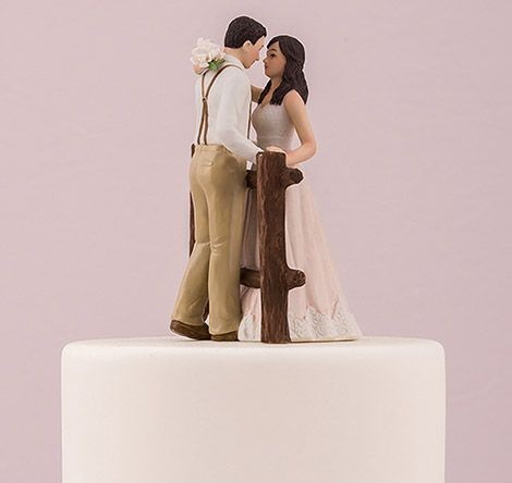 The Rustic Couple Porcelain Figurine Wedding Cake Topper is perfect for the couple looking to add country charm to their wedding cake.