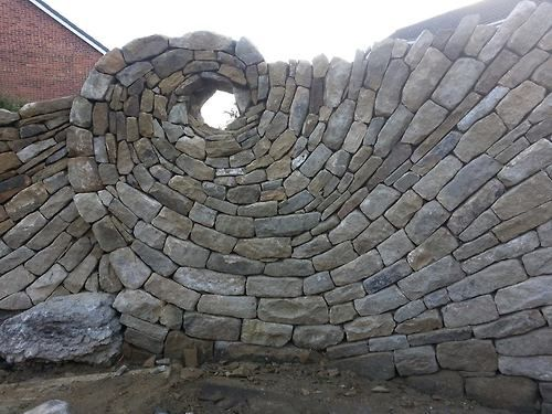 "Dry stack wall by Johnny Clasper, a stonemason/sculptor. His caption for this picture is... ""The person who says it cannot be done, should not interrupt the person doing it."" Chinese Proverb."