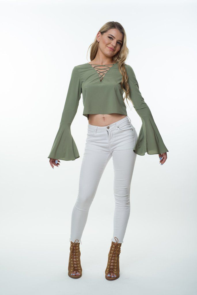 Long sleeve khaki top, perfect for that gypsy chic look.Lace up cropped blouse featuring bell sleeves, your must have for this season. Soft and flowyand so comfortable.  Lining: Not Lined Sheer: None Sheer Our model is wearing size 6