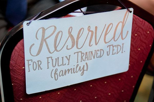 Block off certain seats for family members and the bridal party.Photo Credit: I Do! Aisle Runners