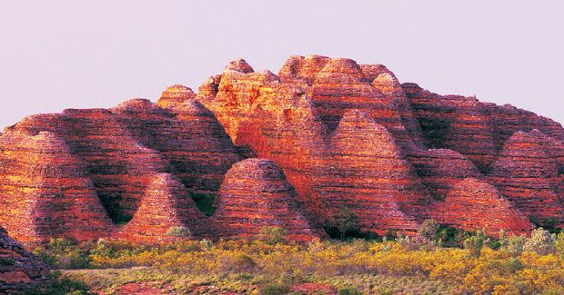 World Heritage site: Purnululu National Park, Western Australia.    The banded, beehive-shaped quartz sandstone towers of the Bungle Bungle Range, located within Purnululu National Park, are considered the most outstanding examples of such formations in the world.