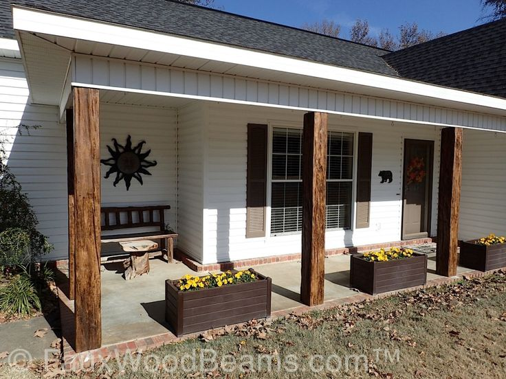 Porch posts covered with faux wood beams.