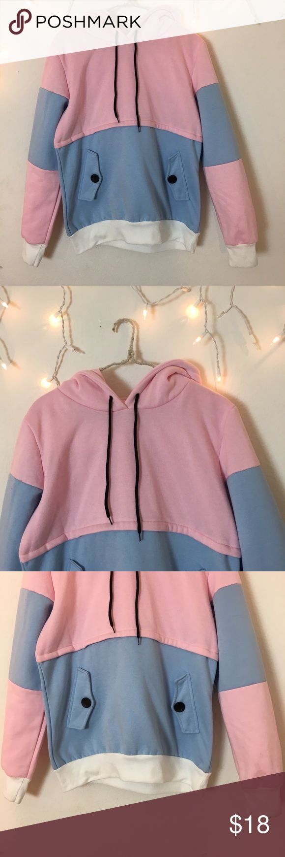 Pastel Dreams Hoodie Super soft and comfortable pastel pink blue and white hoodie with black statement buttons. For a size small or medium for that cute oversize look! Brand-new out of the package never worn. NOT UNIF UNIF Tops Sweatshirts & Hoodies