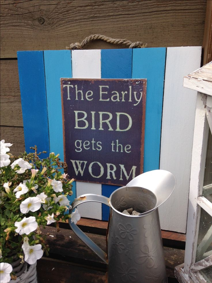 planks nailed together and painted blue and white. metal sign with text on it screwed