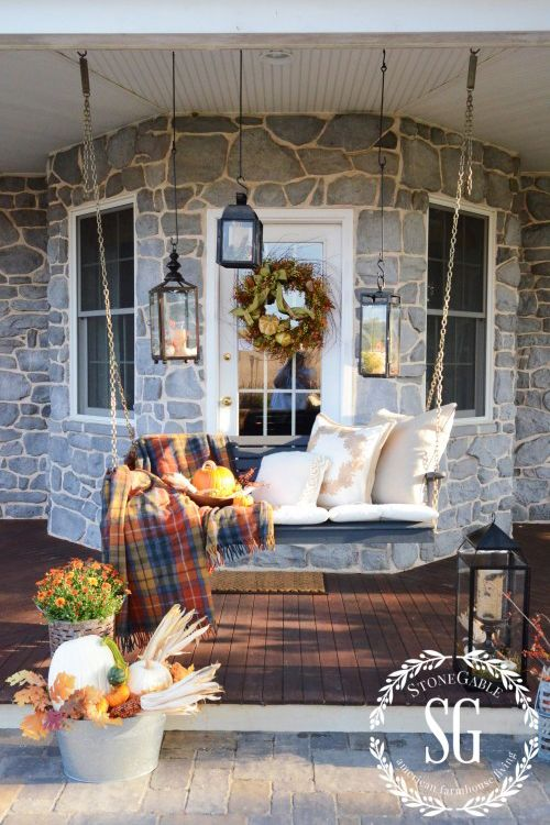 If your porch is always adorned in furniture, transform it for fall with a few quick updates. This porch swing went from a summer hangout spot to a cozy autumn retreat thanks to plush pillows and a tartan throw.