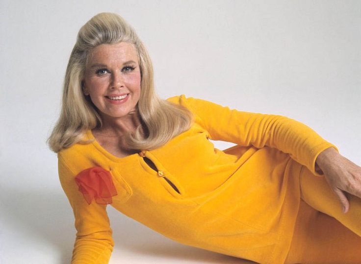 I could never get away with wearing a yellow pant suit, but Doris Day could!