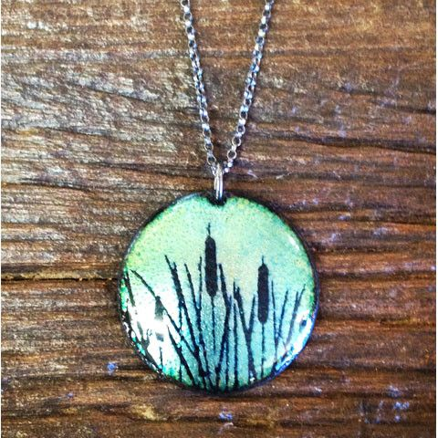 "Daria Salus Jewelry - Cattails Pendant Shown here is the Daria Salus Cattails Pendant. Hand crafted copper enamel work, this beautiful pendant has a blue/green hue. Measuring 1"" in diameter and hangs"