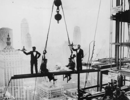 Waiters serve two for lunch on a steel girder high above New York City (1930)