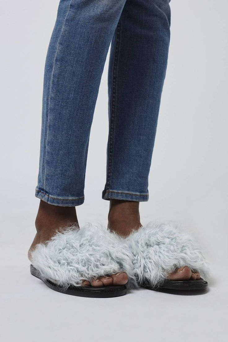 Shearling is everything right now and we're embracing the trend with these must-have sliders. Crafted from a soft leather, the flat style features a statement shearling detail to the top, and an easy to wear design. #Topshop