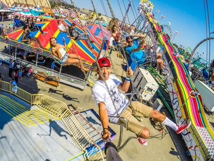 Photo of the Day! A sunny day at the fair. Photo by Jonny Byrne. #GoPro #Family #swings
