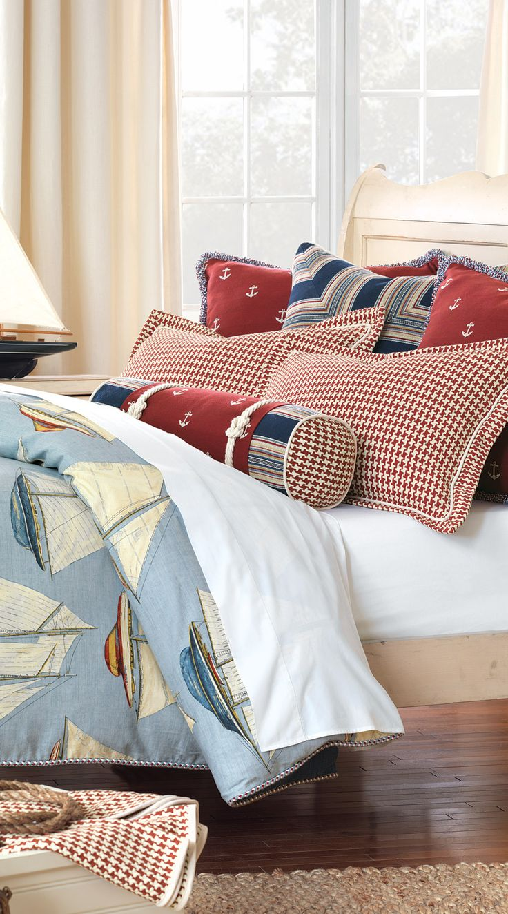 Nautical anchor pillows, the bolster and duvet... great for coastal vibe