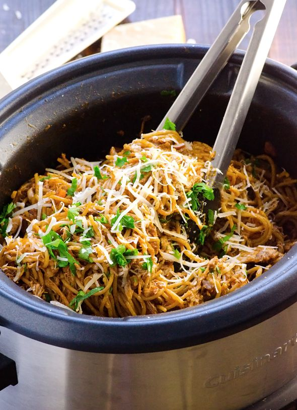 Healthy Crockpot Chicken Spaghetti is a true 10 hour slow cooker recipe with whole wheat pasta and tomato sauce, and without velveeta.