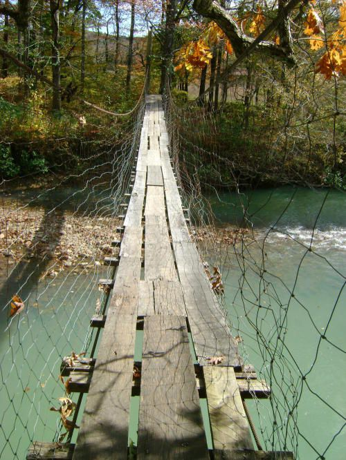 Swinging Bridge, Ozark National Forest, Arkansas.  Our swing bridge here n Heber Springs AR had a tragic ending...This isn't the same bridge is it?