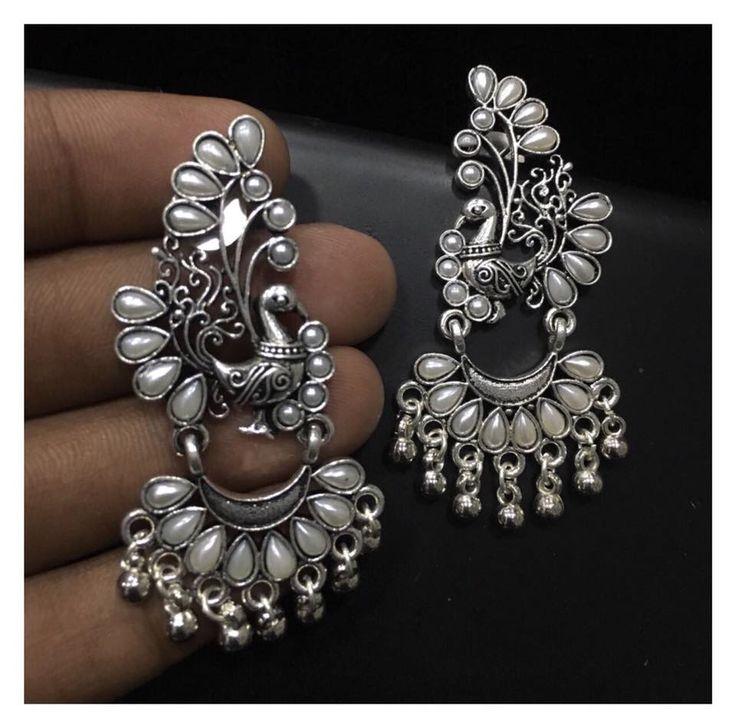 Beautiful german silver ear rings with peacock design. 15 October 2017.