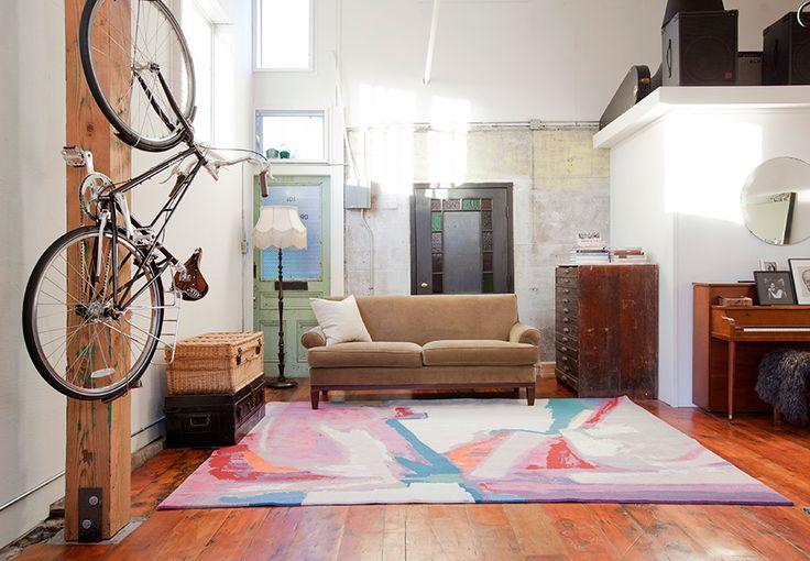 Rug: Over Oceans   Photo: Janis Nicolay   Designer: Kaili Zavenbergen   #abstract #abstractrug #interiordesign #roomdesign #ruginterior #2017rugs #colourfulrugs #artistrugs #zoepawlak #montreal #vancouver #burrittbrothers #loft #loftinterior #loftdesign