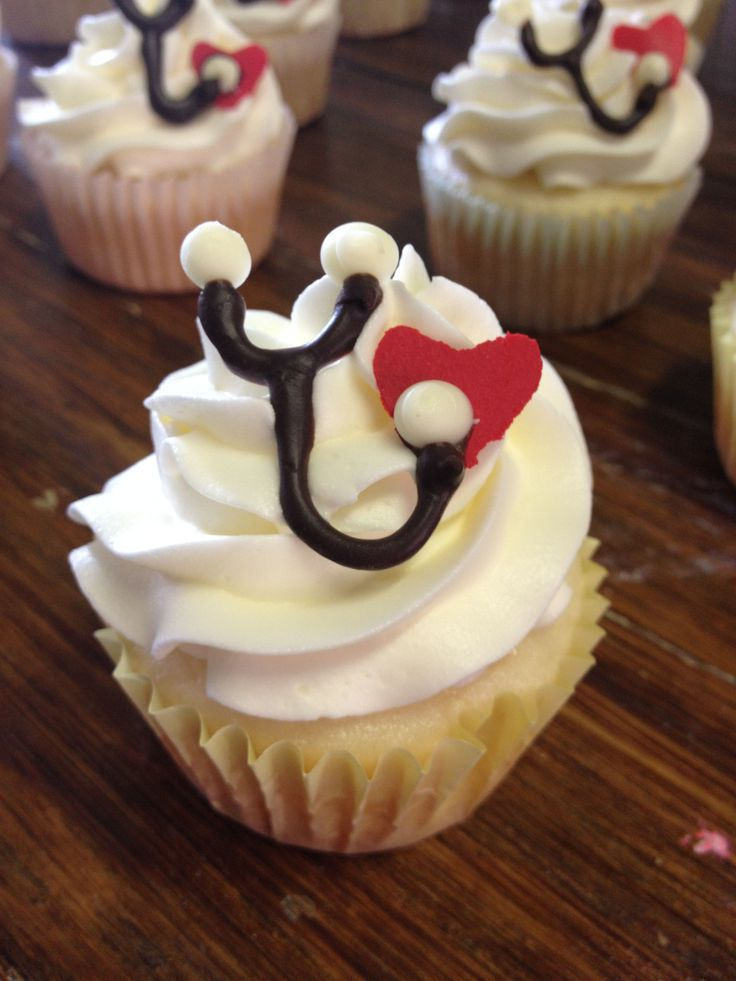Nursing cupcakes for a recent RN graduate! White cake / frosting, topped with a handmade chocolate stethoscope!  Http://thejohnsonfamilyblog.weebly.com