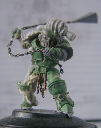 Page 10 of 10 - Jokaero Weaponsmith's Iron Hands-  Immortal - posted in + WORKS IN PROGRESS +: Maybe a smaller shield would work better?  Then you could still see the damaged shoulder pad but have the awesomeness that a shield brings to the model.