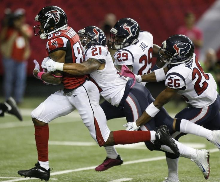 Atlanta Falcons wide receiver Leonard Hankerson (85) is brought down by Houston Texans defensive back Darryl Morris (21), defensive back Andre Hal (29) and free safety Rahim Moore (26) after a 50-yard reception during the third quarter of an NFL football game at the Georgia Dome on Sunday, Oct. 4, 2015, in Atlanta. ( Brett Coomer / Houston Chronicle )
