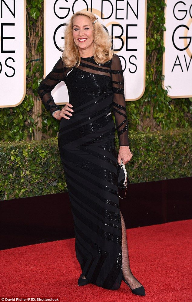 Strike a pose: Jerry, 59, donned an elegant black gown for the evening, pairing her dress with a pair of simple black pumps, a silver and black clutch and some fishnet tights