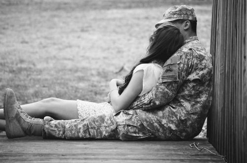 Such a cute picture! No better place than being held tight in my airman's arms <3 miss you so much!