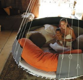 The Floating Bed Co.  Expensive, but they claim to be helpful for autism/fragile x kids.  Anybody seen a study on this?