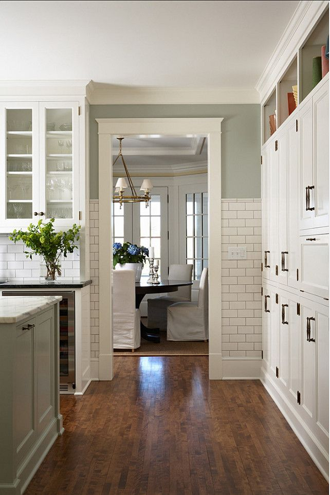 wall of cabinets.  subway tile w gray grout up the wall