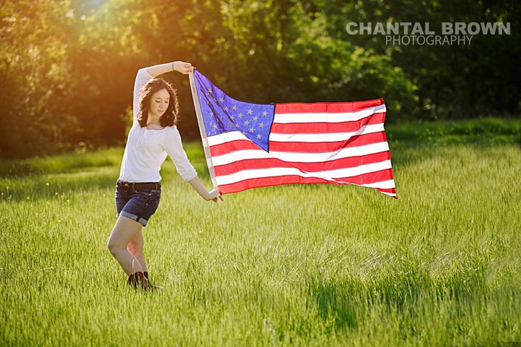 High School Senior Portraits holding American Flag in Dallas field by Chantal Brown Photography.