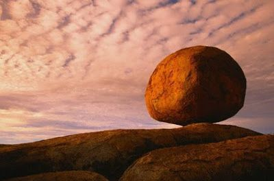 Immense egg-shape boulders called Karlu Karlu sit exposed in desert air at the Devils Marbles Conservation Reserve in the Northern Territory of Australia.