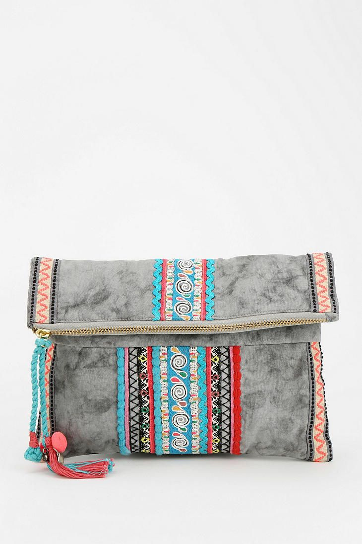"be-ribboned clutch: embroidered crossbody clutch, pull-zip pocket opening along the fold-over front-flap, lined interior with 2 open pockets & a zip pocket, removable mini-chain link shoulder strap, hidden magnetic-snap closure, measurements 11"" x 11"""