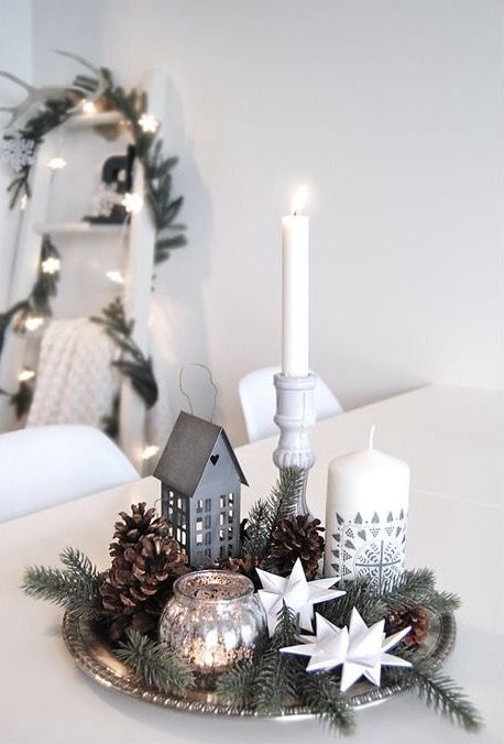 Simple Christmas decor on a silver tray. A beautiful way to group smaller decor items for more visual impact.