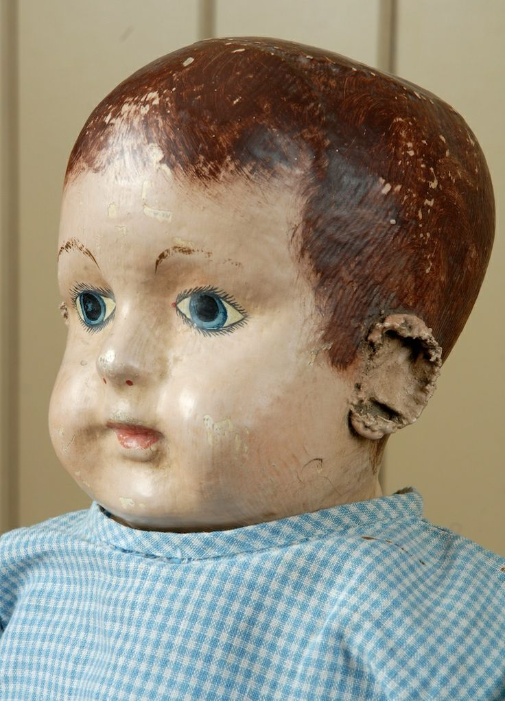 "Close-up of an early 21"" cloth Indestructible Baby doll, Roanoke, Alabama, United States, 1910, by Ella Smith.  For a time Smith's factory in Roanoke produced as many as 10,000 dolls a year leading up to the Great Depression.  This version, with an unusual unpainted body and interestingly applied ears shows the variety of Smith's artistry and her experimental nature as an artist."